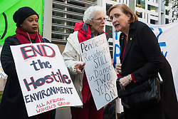 London, UK. 17 October, 2019. Emma Dent Coad, Labour MP for Grenfell constituency Kensington, speaks to Ruth London of Fuel Poverty Action (FPA), at a protest outside the Ministry of Housing, Communities and Local Government (MHCLG) before delivering a letter signed by FPA, 80 organisations, trade unions and MPs in just ten days precisely one year after a strongly worded letter about the urgency of recladding flammable buildings and insulating those that are cold was delivered to the Government department. Commitments made by the MHCLG in response to the original letter have not been met. Credit: Mark Kerrison/Alamy Live News