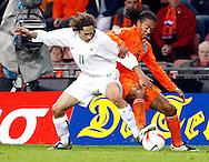17-10-2007: Voetbal: Nederland-Slovenie: Eindhoven<br /> Andrej Komac in duel met Urby Emanuelson<br /> Foto: Geert van Erven