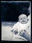 baby in the arms of the mother ca 1920s