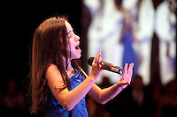 "(CH) Julia Dale, 11, sings ""America The Beautiful"" at the Hispanic Unity.of Florida's 30th Anniversary Gala and fundraiser Noche De Estrellas, on Saturday, September 22, 2012, at the Westin Diplomat Resort & Spa in Hollywood.. Staff photo/Cristobal Herrera"