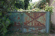 Rusting front gates of abandoned home and land in the village of Bakonygyirot, Gyor-Moson-Sopron, Hungary