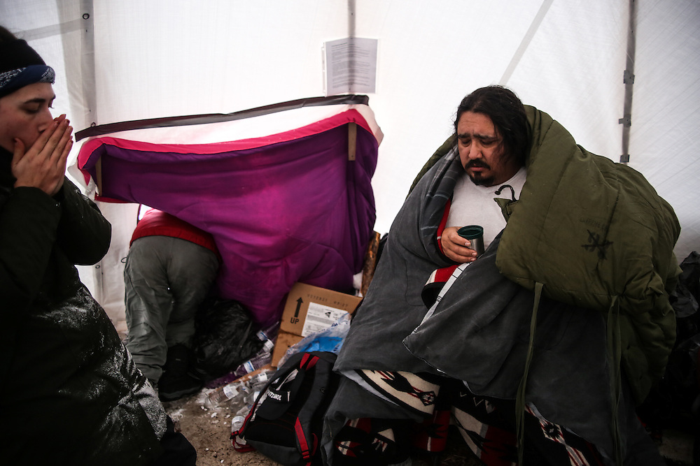 Toby Joseph sits after being attended by medics for nausea and heavy chest symptoms during the first days of harsh winter at the Rosebud Camp at the Standing Rock Indian Reservation in Cannon Ball, North Dakota in December 2016. Joseph was evacuated out of camp shortly after to a safer area until the blizzard was to calm.<br /> <br /> Volunteer medics worked around the clock during one of North Dakota's harshest winters in years. Protestors were being treated for hypothermia, trench foot, and asthma symptoms among others.