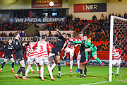 Marko Marosi of Doncaster Rovers (13) punches the ball clear during the EFL Sky Bet League 1 match between Doncaster Rovers and Barnsley at the Keepmoat Stadium, Doncaster, England on 15 March 2019.