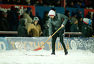 Wakefield Ground staff clear the snow during play Wakefield Trinity vs Widnes Vikings during the Betfred Super League match at Mobile Rocket Stadium, Belle Vue, Wakefield<br /> Picture by Stephen Gaunt/Focus Images Ltd +447904 833202<br /> 17/03/2018