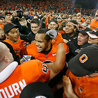 Oregon State's Lyle Moevao celebrates with Greg Laybourn after the Beavers upset USC 27-21 in a Pac-10 conference game on Thursday September 25, 2008. Laybourn had an interception late in the fourth quarter that sealed the vicotry