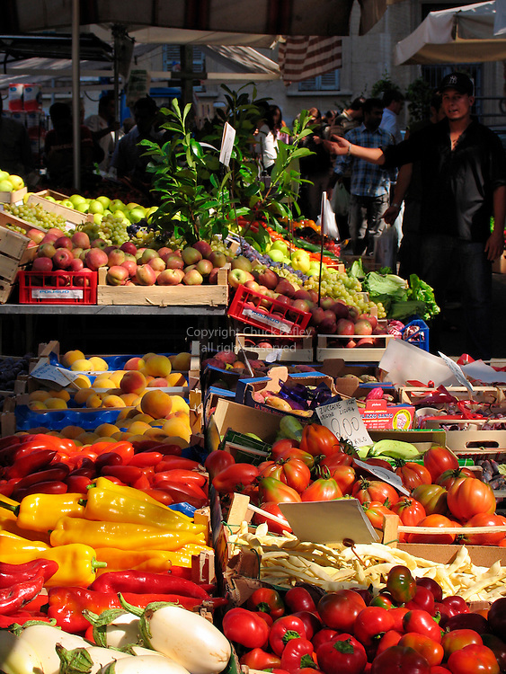 Fresh vegetables and fruit at outdoor street market, Viale d Papiniano, Milan, Italy