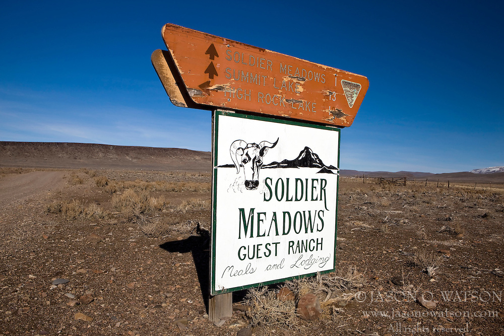 Bureau of Land Management sign indicating distances to Soldier Meadows, Summit Lake and High Rock Lake, on top of Solider Meadows Guest Ranch sign, Black Rock Desert, Gerlach, Nevada.