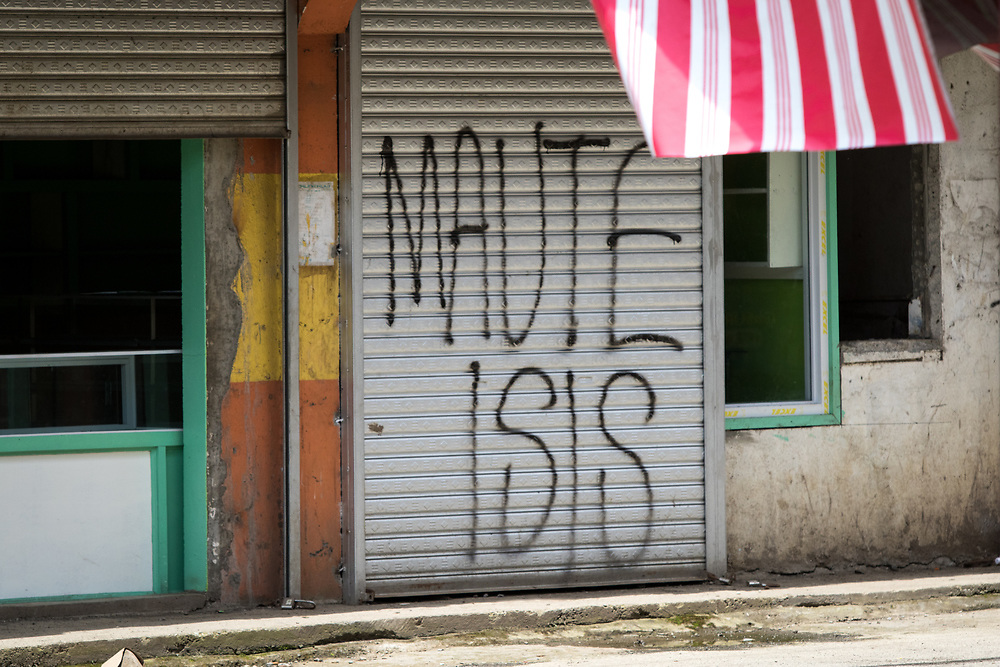 """MARAWI, PHILIPPINES - JUNE 9: Abandoned house vandalized with """"MAUTE ISIS"""" is seen in a door of a house inside of a NO GO ZONE in Marawi, southern Philippines on June 9, 2017. Philippine military jets fired rockets at militant positions on Friday as soldiers fought to wrest control of the southern city from gunmen linked to the Islamic State group.(Photo: Richard Atrero de Guzman/NUR Photo)"""