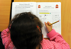 A generic stock photo shows Primary School children at work in a classroom.