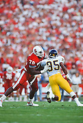 PALO ALTO, CA -  NOVEMBER 18:  Bob Whitfield #70 of the Stanford Cardinal blocks DeWayne Odom #95 of the California Golden Bears during the 1989 Big Game played on November 18, 1989 at Stanford Stadium in Palo Alto, California.  Stanford won 24-14.