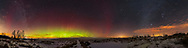 A 240&deg; panorama of a not very active display of Northern Lights to the north (left of centre), then sweeping around to the south (at right) and the winter stars of Orion and Canis Major. Sirius is bright and in some cloud, accentuating its size and colour. Leo is rising at centre. The Big Dipper and Ursa Major are left of centre. The Milky Way appears at far left, in the area of Perseus and Cepheus, and again at far right through Monoceros and past Orion and Canis Major. <br /> <br /> The aurora display the characteristic green and red curtains from oxygen, but there is also a dim red curtain at left (northwest) and at centre (east) south of the main curtain and separated. It looks like a dim Steve arc but this was not visible to the eye and never became well formed or bright. <br /> <br /> This is a stitch of 8 segments with the 14mm Sigma Art lens, at f/2 for 13 seconds each, and Nikon D750 at ISO 3200. Stitched with Adobe Camera Raw. Taken from home January 13, 2018. The constellations are distorted slightly by the panorama projection and warping. <br /> <br /> I began a time-lapse after this, but clouds rolled in from the northwest.