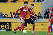 Middlesbrough striker Diego Fabbrini plays the ball away from Wolverhampton Wanderers defender Matt Doherty during the Sky Bet Championship match between Wolverhampton Wanderers and Middlesbrough at Molineux, Wolverhampton, England on 24 October 2015. Photo by Alan Franklin.