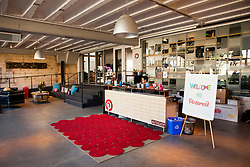 Scenes from Pinterest Headquarters in San Francisco, California.  The front welcome desk area.