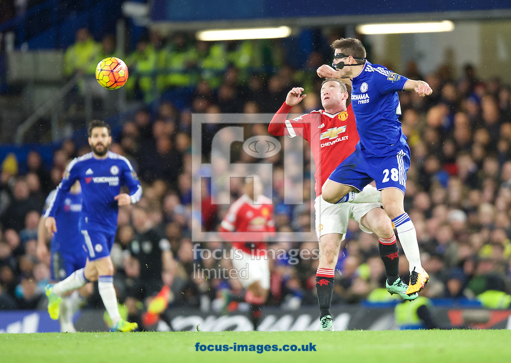 Cesar Azpilicueta of Chelsea wins the header from Wayne Rooney of Manchester United during the Barclays Premier League match at Stamford Bridge, London<br /> Picture by Alan Stanford/Focus Images Ltd +44 7915 056117<br /> 07/02/2016