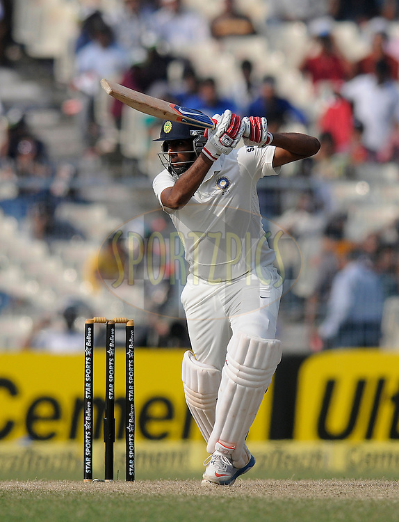 Ravichandran AShwin of India bats during day two of the first Star Sports test match between India and The West Indies held at The Eden Gardens Stadium in Kolkata, India on the 7th November 2013<br /> <br /> Photo by: Pal Pillai - BCCI - SPORTZPICS