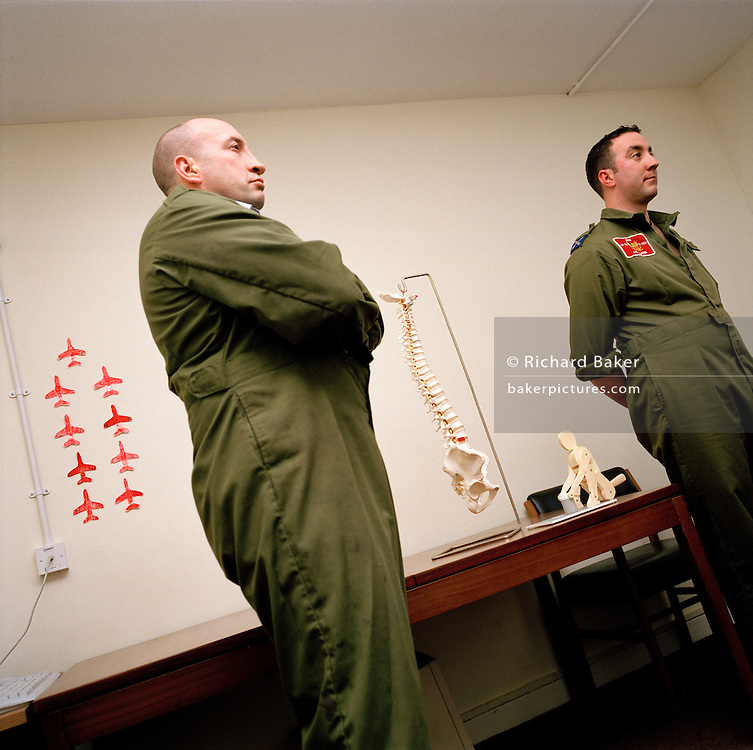 Engineering ground staff of the Red Arrows, Britain's RAF aerobatic team, listen during health and safety course.