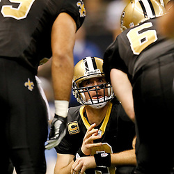 November 28, 2011; New Orleans, LA, USA; New Orleans Saints quarterback Drew Brees (9) in the huddle against the New York Giants during the second quarter of a game at the Mercedes-Benz Superdome. The Saints defeated the Giants 49-24. Mandatory Credit: Derick E. Hingle-US PRESSWIRE