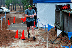 January 19, 2019 - Southern Pines, North Carolina, US - Jan. 19, 2019 - Southern Pines N.C., USA - A member of the Hoodlums and Brigands relay team completes the final lap winning first place in the relay division during the 10th Annual Weymouth Woods 100km ultra marathon at the Weymouth Woods Nature Preserve. Runners needed to complete 14 laps of the 4.47 mile course for 62.58 miles in under the 20-hour time allotment. (Credit Image: © Timothy L. Hale/ZUMA Wire)