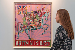 "© Licensed to London News Pictures. 16/01/2018. LONDON, UK. A staff member views ""Britain is best"" by Grayson Perry. Preview day of the 30th anniversary of the London Art Fair.  The fair launches the international art calendar with modern and contemporary art from leading galleries around the world and is taking place at the Business Design Centre, Islington from 17 to 21 January 2018.   Photo credit: Stephen Chung/LNP"