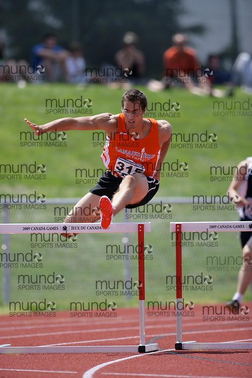 (Charlottetown, Prince Edward Island -- 20090719) Gabriel El Hanbli of Lanaudiere-Olympique competes in the 400m hurdles final at the 2009 Canadian Junior Track & Field Championships at UPEI Alumni Canada Games Place on the campus of the University of Prince Edward Island, July 17-19, 2009.  Copyright Sean Burges / Mundo Sport Images , 2009.