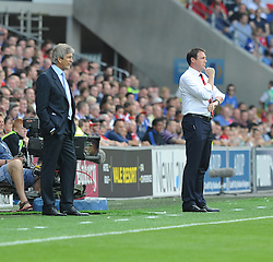 Manchester City Manager, Manuel Pellegrini and Cardiff City Manager, Malky Mackay watch on. - Photo mandatory by-line: Alex James/JMP - Tel: Mobile: 07966 386802 25/08/2013 - SPORT - FOOTBALL - Cardiff City Stadium - Cardiff -  Cardiff City V Manchester City - Barclays Premier League