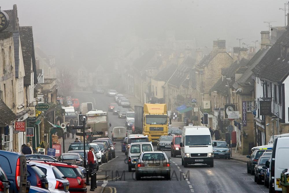 Traffic on Burford High Street, Oxfordshire, United Kingdom