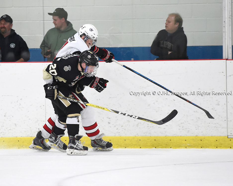 GEORGETOWN, ON - APR 18,  2017: Ontario Junior Hockey League, Championship Series. Georgetown Raiders vs the Trenton Golden Hawks in Game 3 of the Buckland Cup Final.  Louis DiMatteo #20 of the Trenton Golden Hawks battles for control with Keegan Blasby #11 of the Georgetown Raiders during the second period.<br /> (Photo by Andy Corneau / OJHL Images)