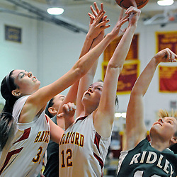 TOM KELLY IV &mdash; DAILY TIMES<br /> Haverford's Amanda Battista (32) Rosie O'Halloran (12) and Ridley's Hanna Crowley (12) fight for a rebound during the Ridley at Haverford girls basketball game, Friday night.