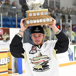 TRENTON, ON - Apr 22, 2016 -  Ontario Junior Hockey League game action between the against the Trenton Golden Hawks and the Georgetown Raiders. Game 5 of the Buckland Cup Championship Series, at the Duncan Memorial Gardens in Trenton, Ontario. Ethan Skinner #14 of the Trenton Golden Hawks with the Buckland Cup.<br /> (Photo by Andy Corneau / OJHL Images)
