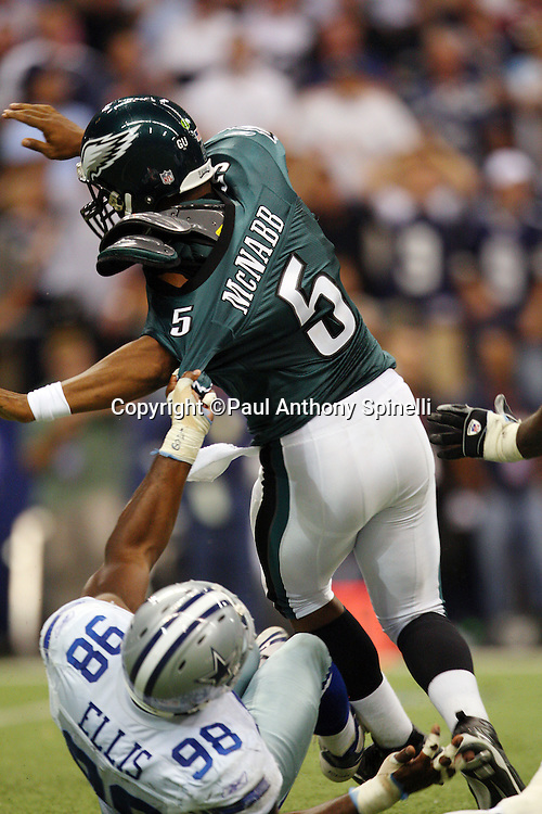 IRVING, TX - SEPTEMBER 15:  Quarterback Donovan McNabb #5 of the Philadelphia Eagles gets sacked by linebacker Greg Ellis #98 of the Dallas Cowboys at Texas Stadium on September 15, 2008 in Irving, Texas. The Cowboys defeated the Eagles 41-37. ©Paul Anthony Spinelli *** Local Caption *** Donovan McNabb;Greg Ellis