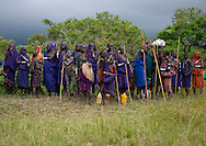 Surma women gather on a small hill to watch the fights in safety. On their feet bottles containing the local beer called gesso. Young women wear necklaces around their neck that will offer to the winner warrior as an acceptance for dating him.
