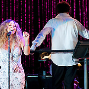 July 13, 2013 - New York, NY : <br /> The New York Philharmonic, lead by Alan Gilbert, standing at right, and accompanied by Mariah Carey, standing at left, perform in the free MLB All-Star Charity Concert to benefit Hurricane Sandy victims, in Central Park's great lawn on July 13, 2013. **THIS IMAGE IS A CROP VARIATION**<br /> CREDIT: Karsten Moran for The New York Times
