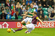 Christophe Berra (#6) of Heart of Midlothian tackles Steven Whittaker (#3) of Hibernian FC during the Ladbrokes Scottish Premiership match between Hibernian FC and Heart of Midlothian FC at Easter Road Stadium, Edinburgh, Scotland on 29 December 2018.