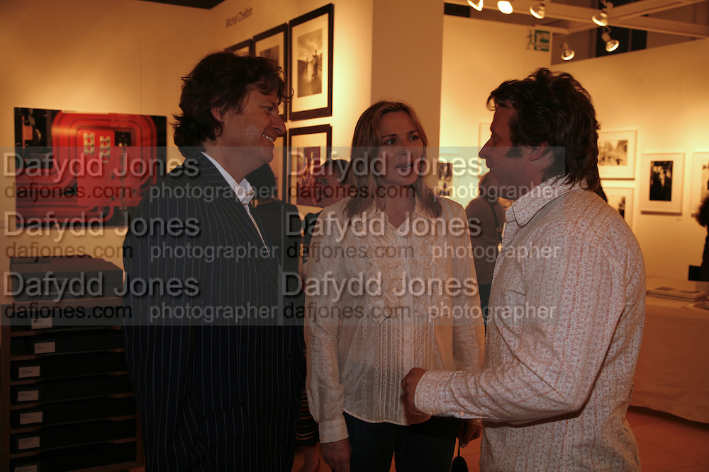 DANNY MOYNIHAN, KIM CATTRELL AND CHARLIE BOORMAN, Opening of Photo-London, Burlington Gdns. London. 17 May 2006. ONE TIME USE ONLY - DO NOT ARCHIVE  © Copyright Photograph by Dafydd Jones 66 Stockwell Park Rd. London SW9 0DA Tel 020 7733 0108 www.dafjones.com