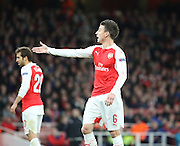 Arsenal defender Laurent Koscielny calling for a foul during the Champions League match between Arsenal and Dinamo Zagreb at the Emirates Stadium, London, England on 24 November 2015. Photo by Matthew Redman.