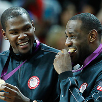12 August 2012: USA Kevin Durant and LeBron James are seen with the gold medal following 107-100 Team USA victory over Team Spain, during the men's Gold Medal Game, at the North Greenwich Arena, in London, Great Britain.