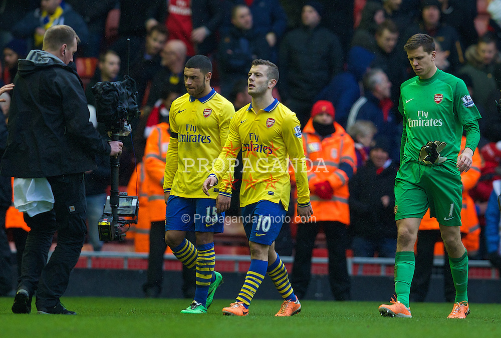LIVERPOOL, ENGLAND - Saturday, February 8, 2014: Arsenal's Jack Wilshere walks off dejected after his side are thrashed 5-1 by Liverpool during the Premiership match at Anfield. (Pic by David Rawcliffe/Propaganda)