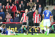 Brentford midfielder, Sam Saunders (7) yellow card during the Sky Bet Championship match between Brentford and Cardiff City at Griffin Park, London, England on 19 April 2016. Photo by Matthew Redman.