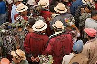 Relatives of graduates wait to enter a hall for graduation festivities, Nebaj, Guatemala.