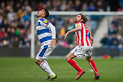Massimo Luongo (Queens Park Rangers) and Joe Allen (Stoke) wait to head the ball during the EFL Sky Bet Championship match between Queens Park Rangers and Stoke City at the Loftus Road Stadium, London, England on 9 March 2019.