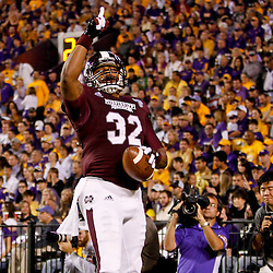 November 10, 2012; Baton Rouge, LA, USA;  Mississippi State Bulldogs tight end Marcus Green (32) celebrates after catching a touchdown during the first quarter of a game against the LSU Tigers at Tiger Stadium.  Mandatory Credit: Derick E. Hingle-US PRESSWIRE