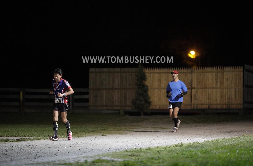 Augusta, New Jersey - Tatsunori Suzuki and Shiran Kochavi run at night during the 3 Days at the Fair races at Sussex County Fairgrounds on May 15, 2010.