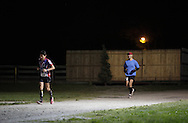 Augusta, New Jersey - Tatsunori Suzuki and Shiran Kochavi run at night during the 3 Days at the Fair races at Sussex County Fairgrounds on May 15, 2010.
