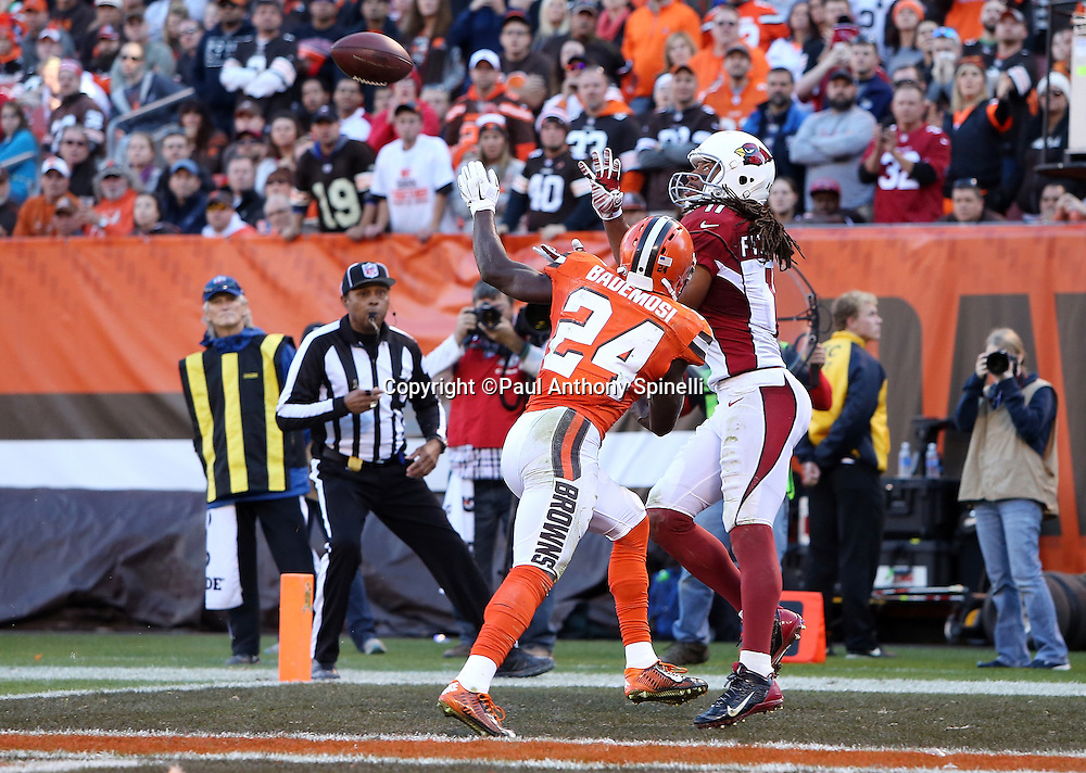 Arizona Cardinals wide receiver Larry Fitzgerald (11) catches a 6 yard fourth quarter touchdown pass that gives the Cardinals a 31-20 lead while covered by Cleveland Browns cornerback Johnson Bademosi (24) during the 2015 week 8 regular season NFL football game against the Cleveland Browns on Sunday, Nov. 1, 2015 in Cleveland. The Cardinals won the game 34-20. (©Paul Anthony Spinelli)