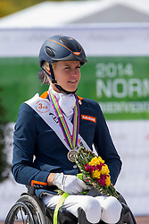 Nicole den Dulk and Wallace win bronze in the Freestyle Grade Ib Para Dressage - Alltech FEI World Equestrian Games™ 2014 - Normandy, France.<br /> © Hippo Foto Team - Leanjo de Koster<br /> 25/06/14