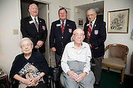 World War I Veteran Harry Landis, 107, at home in Sun City Center.  Landis is one of only four known surviving veterans of WWI.  Also shown is his 99-year-old wife, Eleanor and three retired officers from the Military Officers Association of America, Lt. Col. Paul Wheat, Maj. Jerry Foppe and Cmdr. Ed Socha.