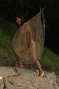 Huaorani women,Ewa Kemperi carrying her fishing net. These nets are made from the fibres of the Chambira palm.<br /> Bameno Community. Yasuni National Park.<br /> Amazon rainforest, ECUADOR.  South America<br /> This Indian tribe were basically uncontacted until 1956 when missionaries from the Summer Institute of Linguistics made contact with them. However there are still some groups from the tribe that remain uncontacted.  They are known as the Tagaeri & Taromenane. Traditionally these Indians were very hostile and killed many people who tried to enter into their territory. Their territory is in the Yasuni National Park which is now also being exploited for oil.