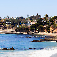 Photo of Laguna Beach oceanfront homes along the beach. Laguna Beach is a seaside beach city in Orange County in Southern California.