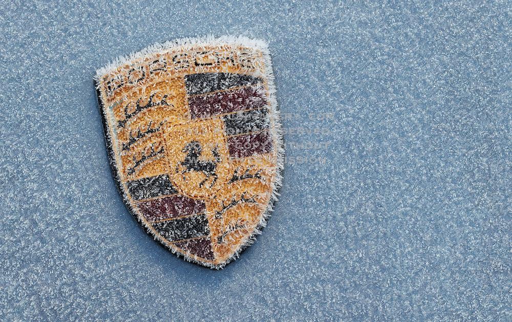 Image of a Porsche 997 hood badge in winter, Washington, Pacific Northwest