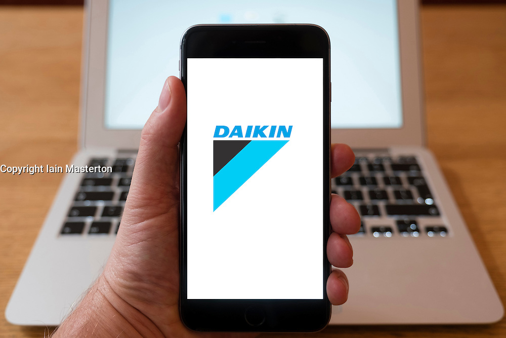 Using iPhone smartphone to display logo of Daikin , Japanese multinational air conditioner manufacturing company